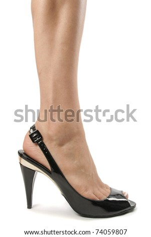 Woman legs wearing high heels over white background