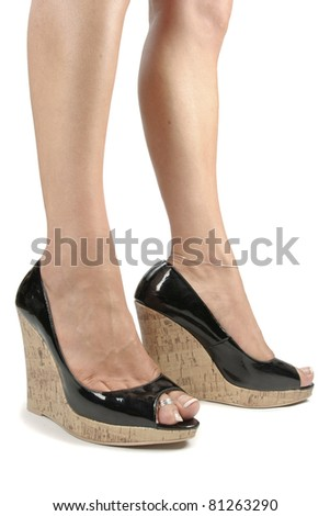 Woman legs wearing high heels over white background - stock photo