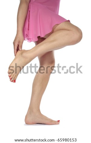 Woman legs with  dress  aching feet over white - stock photo