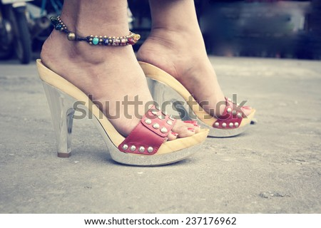 woman legs with high heel shoes - stock photo