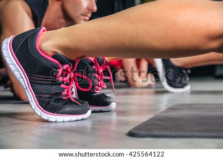 Woman legs with sneakers doing fitness exercises - stock photo