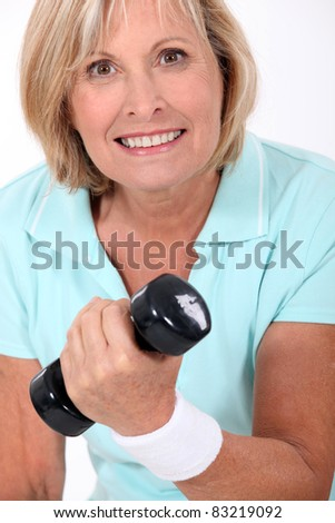 Woman lifting a dumbbell - stock photo