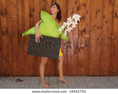 Woman lifting cardboard box while moving. - stock photo
