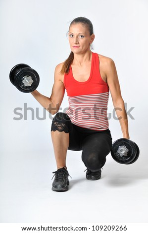 Woman lifting weights in studio