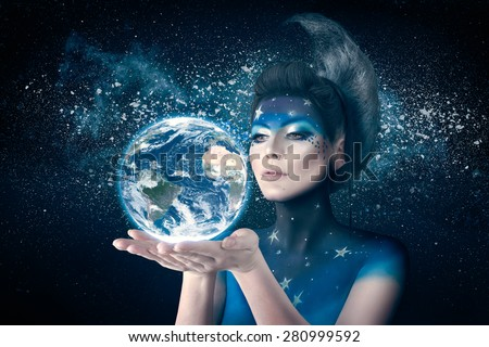 Woman like moon inspired bodyart and hairstyle holding planet earth in hand with care. Element of this image furnished by NASA - stock photo