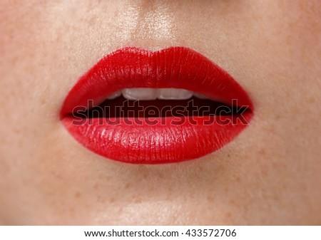 Woman lips close up red lipstick - stock photo