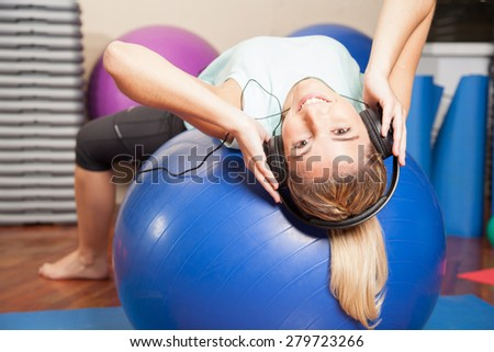 Woman listen to music in yoga class
