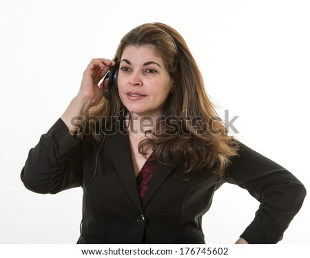 Woman listening carefully to guest in Call Center but about to explode with frustration - stock photo