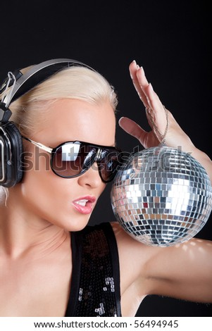 Woman listening music and posing - stock photo
