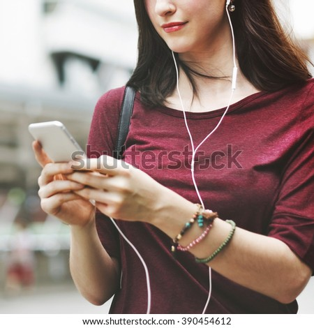 Woman Listening Music Media Entertainment Walking Concept - stock photo