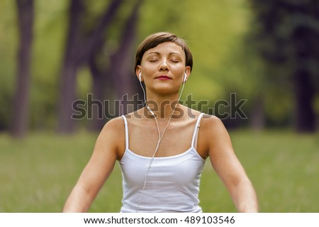 Woman listening music with closed eyes.