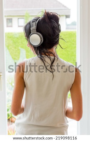 woman listening music with headphones. relax and unwind - stock photo