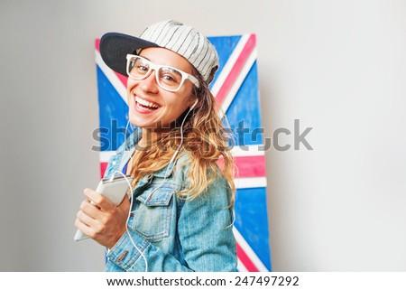 woman listening to british music - stock photo