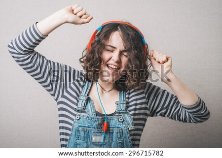 woman listening to music on headphones - stock photo