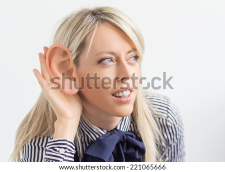 Woman listening with ridiculously big ear - stock photo