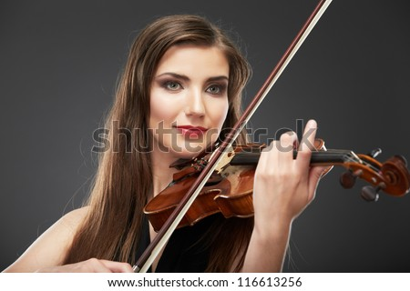 Woman long hair portrait isolated on gray background. Music play violin