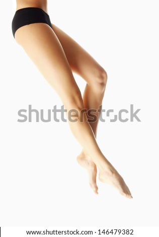 Woman Long Sexy Legs with smooth skin, isolated on white background - stock photo