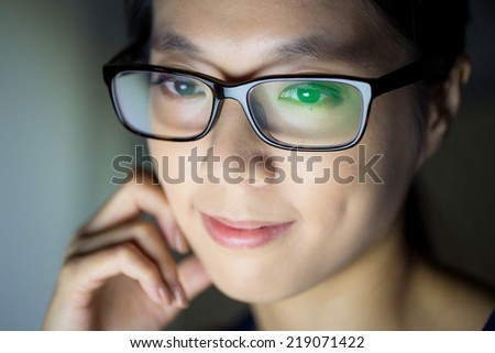 Woman look at computer screen - stock photo