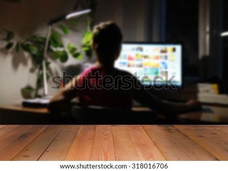 Woman look at computer screen at night - stock photo