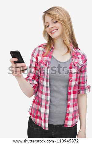 Woman looking at a smart phone against a white background