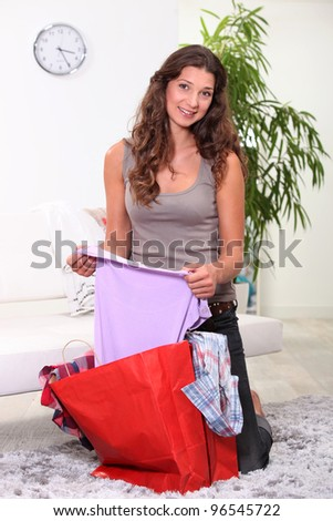 Woman looking at her fashion purchases - stock photo