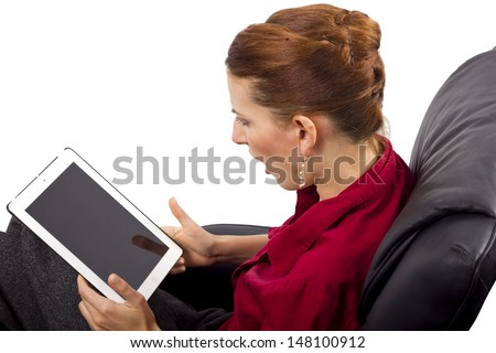 woman looking at tablet computer (blank screen for composites)