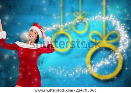 Woman looking at the camera against blurred christmas background - stock photo
