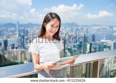 Woman looking at the city map in Hong Kong - stock photo
