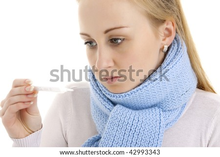 Woman looking at thermometer. Isolated. - stock photo