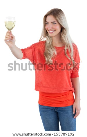 Woman looking at white wine glass on a white background