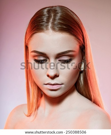 woman looking down. studio shot - stock photo