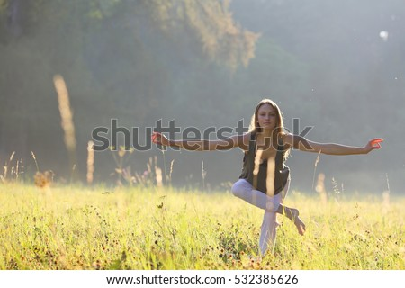 Woman looking for a balance in park
