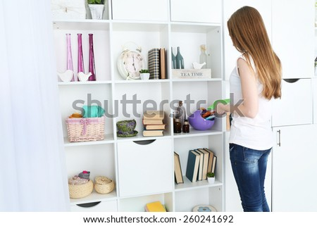 Woman looking for something in closet, in room with modern interior - stock photo