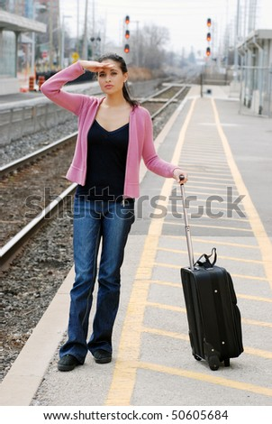 woman looking for the train - stock photo