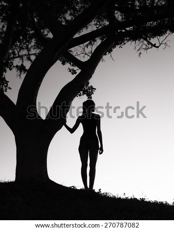 Woman looking out to the horizon.  - stock photo