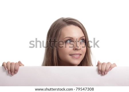 Woman looking over blank card in the studio - stock photo