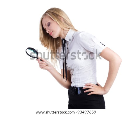 Woman looking through a magnifying glass isolated - stock photo