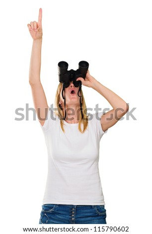woman looking through binoculars and pointing up against a white background - stock photo