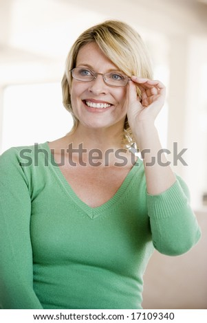 Woman Looking Through New Glasses