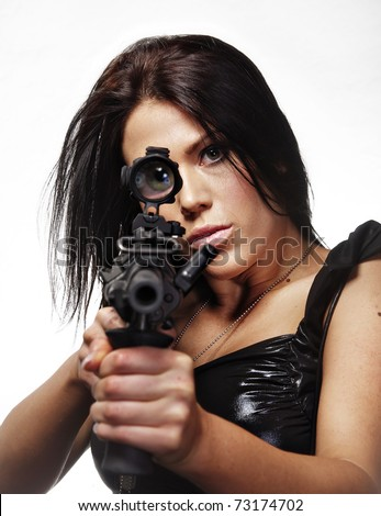Woman looking through the site of a gun - stock photo