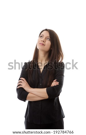woman looking up into the air thinking to herself - stock photo