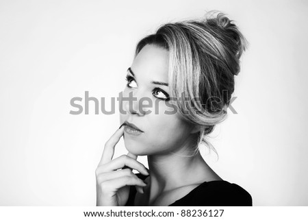 woman looking up thinking something to her self - stock photo