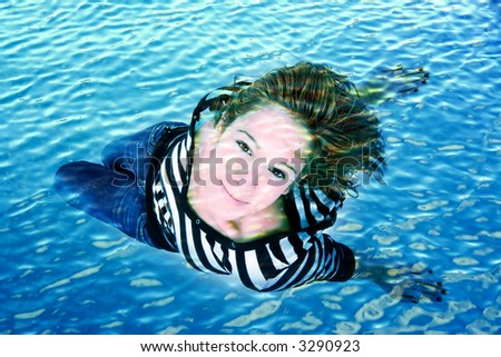 woman looking up under the water