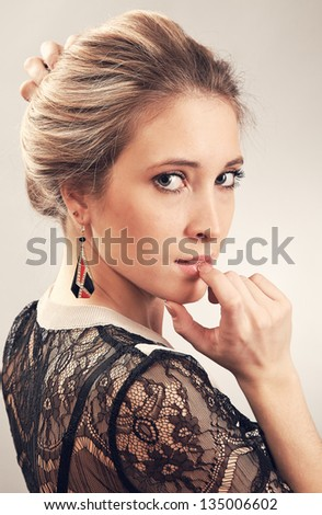 Woman looks over her shoulder - stock photo