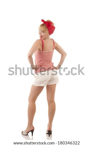 Woman looks over her shoulder ioslated on white - stock photo