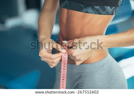Woman losing weight - stock photo