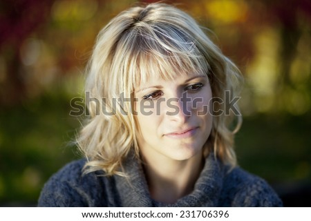 Woman lost in thought. She is worried. - stock photo