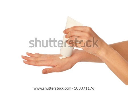 woman lubricates the hands skin with cosmetic cream