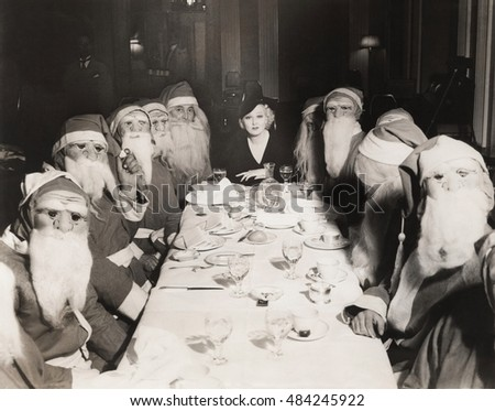 Woman lunching with twelve Santa Clauses