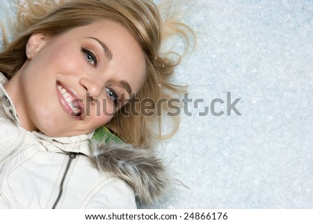 Woman Lying in Snow - stock photo